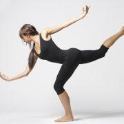 Woman dancing in a black leotard
